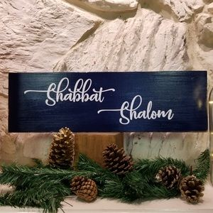 A handcrafted Shabbat Shalom wood sign